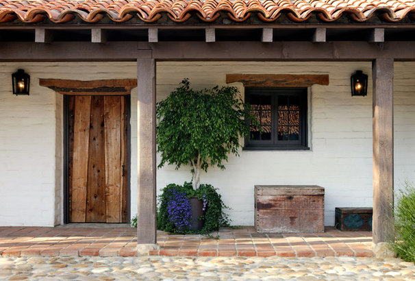 Rustic Exterior by Tom Meaney Architect, AIA
