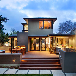 Mid-sized contemporary gray two-story stucco house exterior idea in San Francisco with a hip roof and a shingle roof