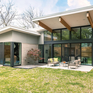 Inspiration for a 1960s glass house exterior remodel in Dallas with a shed roof