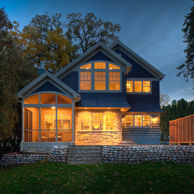 Elegant blue two-story wood exterior home photo in Milwaukee
