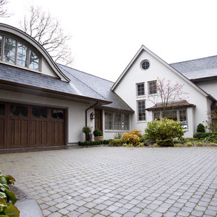 Example of a classic two-story exterior home design in Portland