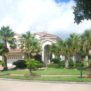 Example of a mid-sized tuscan white two-story stucco exterior home design in Houston