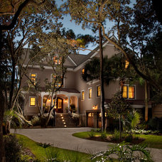 Tropical Exterior by Dolphin Architects & Builders, Inc.