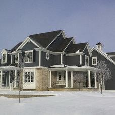Farmhouse Exterior by Ed Saloga Design Build