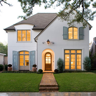 Example of a classic white two-story gable roof design in Houston