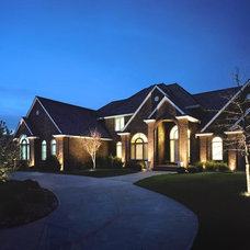 Traditional Exterior by McKay Landscape Lighting
