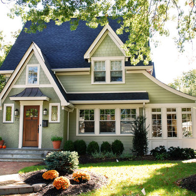 Large craftsman green two-story wood house exterior idea in New York with a shingle roof