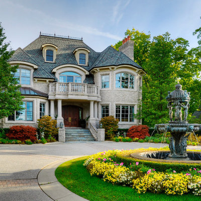Example of a classic stone exterior home design in Detroit