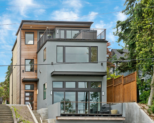 Trendy Gray Three Story Mixed Siding Flat Roof Photo In Seattle