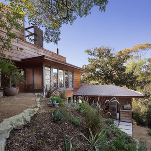 Inspiration for a midcentury brown house exterior in Los Angeles with three or more storeys and wood siding.