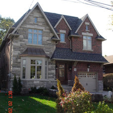 Traditional Exterior by Town Square Developments Inc.