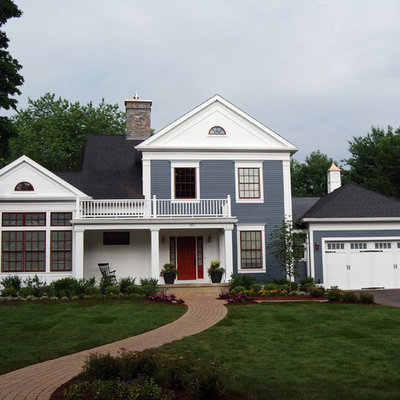 Example of a classic two-story mixed siding exterior home design in Bridgeport