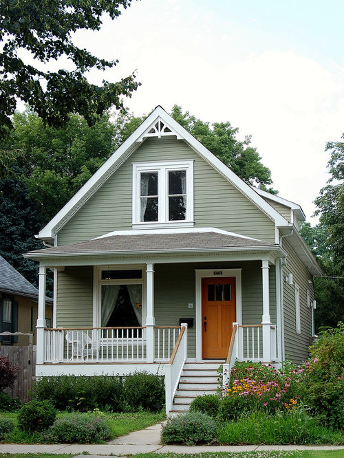 exterior dentil molding sale. small ornate green two-story gable roof photo in chicago exterior dentil molding sale