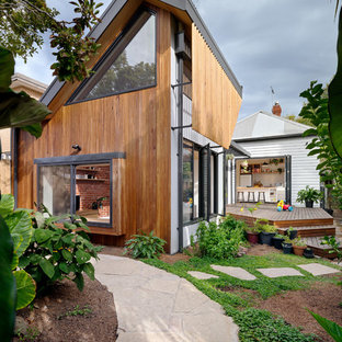 Inspiration for a contemporary two-storey brown house exterior in Melbourne with mixed siding, a shed roof and a metal roof.