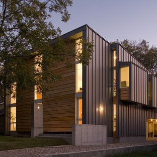Inspiration for a modern exterior in Austin with metal cladding.