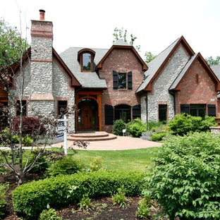 Large rustic two-story mixed siding exterior home idea in Detroit with a shingle roof