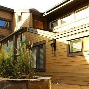 Mid-sized industrial brown two-story wood house exterior idea in Salt Lake City with a shingle roof