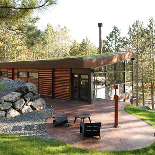 Inspiration for a rustic wood exterior home remodel in Minneapolis with a shed roof