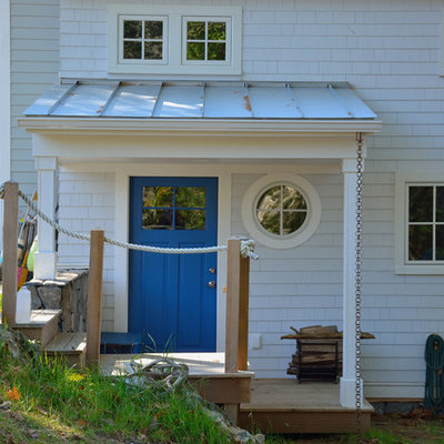 Example of a large beach style blue two-story wood exterior home design in Portland Maine