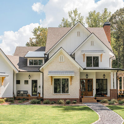 Example of a large farmhouse white two-story mixed siding exterior home design in Atlanta with a mixed material roof