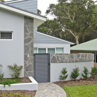Mid-sized trendy blue two-story exterior home photo in Sydney