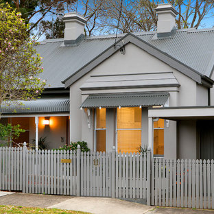 Transitional one-storey grey house exterior in Sydney with a metal roof and a gable roof.