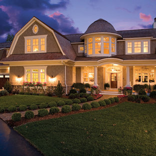 Example of a huge coastal beige two-story wood exterior home design in Minneapolis