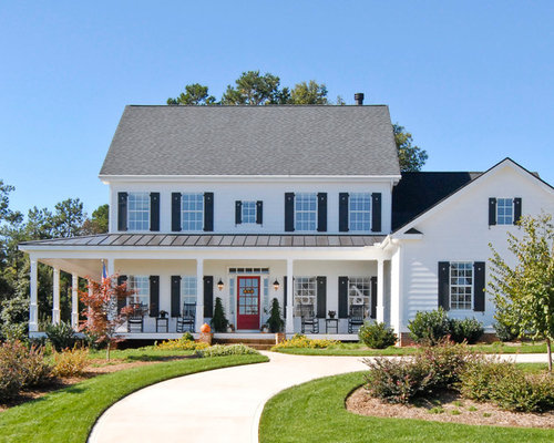 Farmhouse White Two Story Exterior Home Idea In Charleston With A Mixed Material Roof