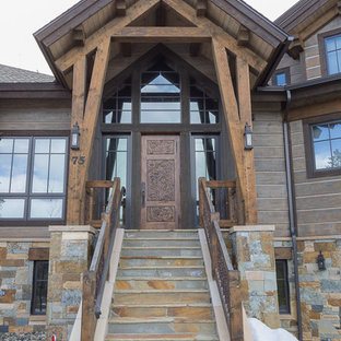 Inspiration for a huge scandinavian brown two-story wood exterior home remodel in Denver