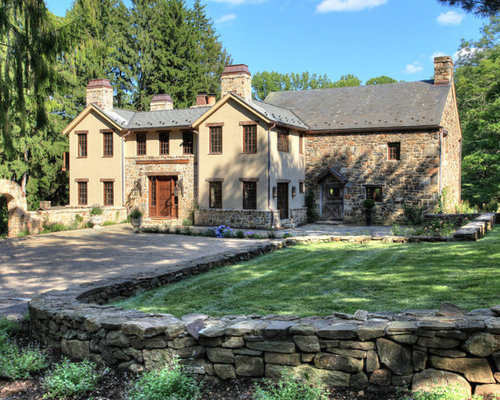 inspiration for a farmhouse two story stone exterior home remodel in new york