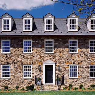 Inspiration for a cottage stone exterior home remodel in DC Metro