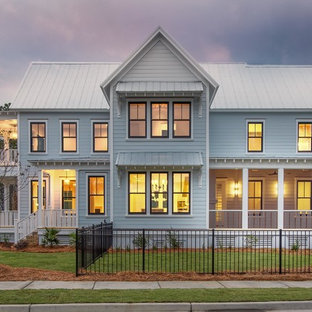 Farmhouse gray two-story exterior home photo in Charleston