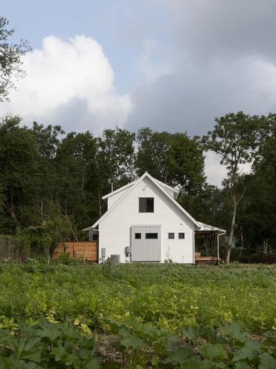 Farmhouse Exterior by Rauser Design