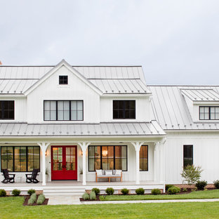 Inspiration for a country white two-story wood and board and batten exterior home remodel in Baltimore with a metal roof