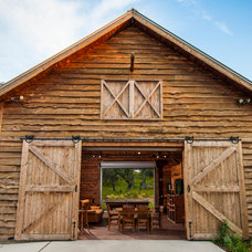Farmhouse Exterior by HeritageBarns.com