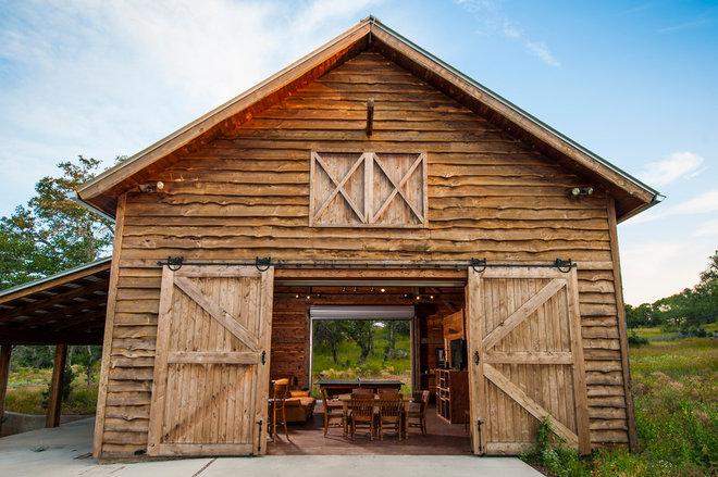 Farmhouse Exterior by HeritageBarns.com