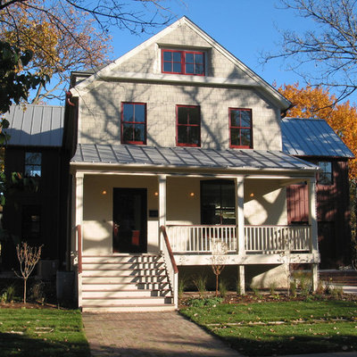 Large farmhouse three-story wood exterior home idea in Chicago