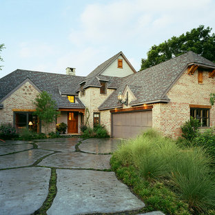 Example of a cottage brick exterior home design in Dallas