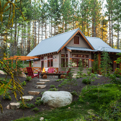 Mid-sized mountain style gray one-story wood gable roof photo in Seattle