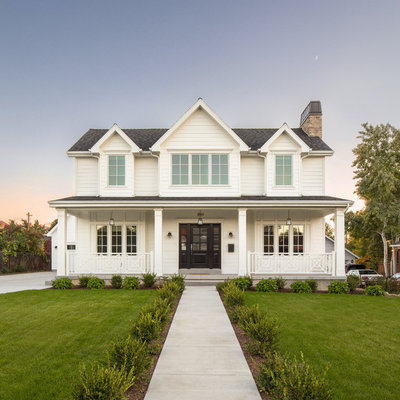 Inspiration for a cottage white two-story exterior home remodel in Salt Lake City with a shingle roof
