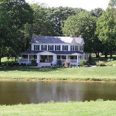 Farmhouse Exterior by Makatura Construction, Inc.