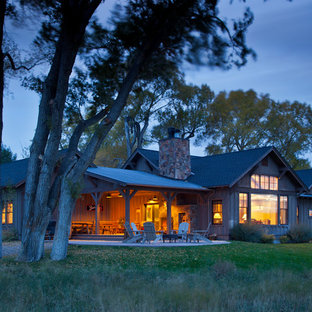 Inspiration for a large rustic brown one-story wood house exterior remodel in Other