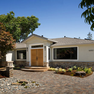 Mid-sized transitional green one-story stone exterior home photo in San Francisco with a hip roof
