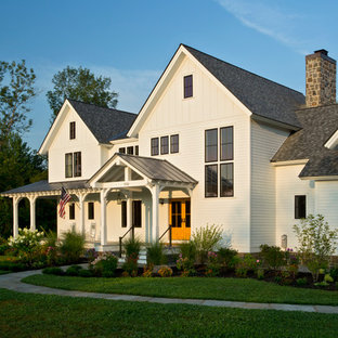 Large country white three-story wood gable roof photo in Boston with a mixed material roof