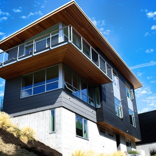 Example of a trendy black two-story wood exterior home design in Seattle