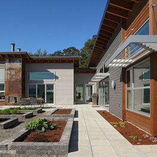 Стильный дизайн: дом в стиле лофт с облицовкой из металла - последний тренд
