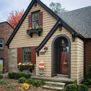 Small elegant beige two-story mixed siding exterior home photo in Detroit with a shingle roof