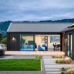 Свежая идея для дизайна: одноэтажный, черный дом в современном стиле - отличное фото интерьера
