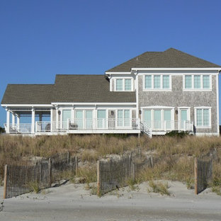 Example of a mid-sized coastal gray three-story wood gable roof design in Wilmington