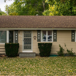 Small traditional beige one-story vinyl gable roof idea in Omaha